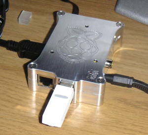 My Raspberry Pi in its Pi Holder aluminum case, and some dust.